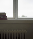 Stack of Books on Windowsill