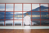 Man Staring at Wall Photo in Conference Room, back view