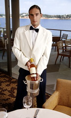 Waiter displaying wine bottle
