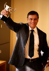 Businessman holding trophy