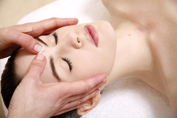 Woman having facial massage