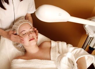 Woman having a facial treatment at a spa