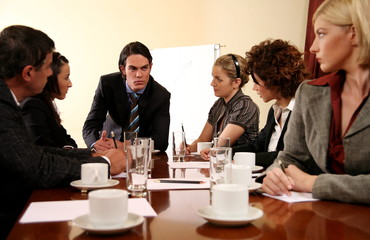 A group of business people at a meeting