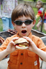 Young boy eating a hamburger