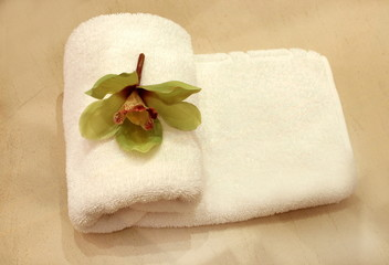 Folded towel with flower