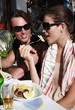Young couple eating at restaurant table