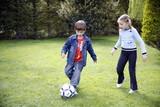 Fototapety Children playing soccer