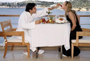 Couple having breakfast on hotel terrace