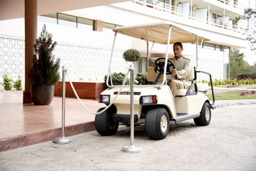 Bellboy driving hotel cart