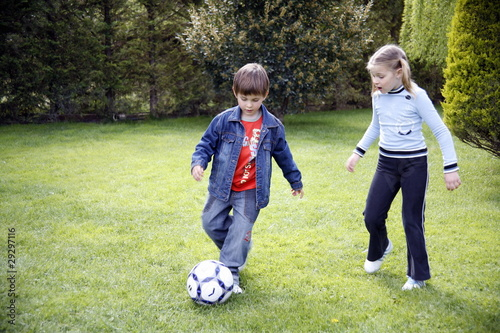 Children playing soccer
