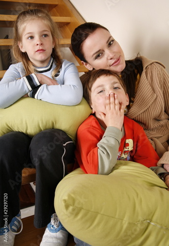 Mother with tired children on staircase