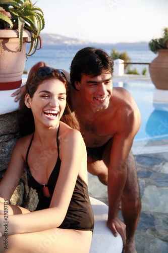 Couple at seaside swimming pool