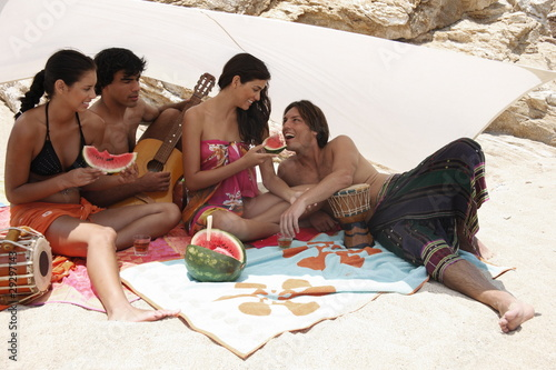 Two couples on beach having fun