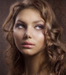 Beauty Portrait with perfect skin and healthy curly hair