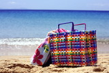 Beach bag with towel on beach