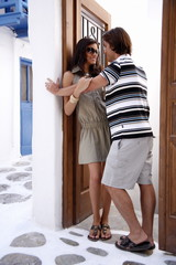 Couple about to kiss in doorway