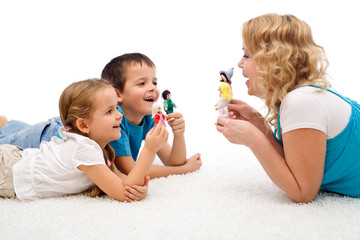 Happy woman and kids playing on the floor