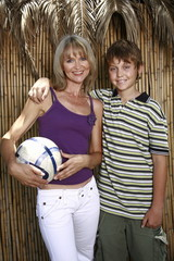 Mother with son and ball