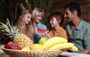 Parents with children and fruit