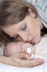 Young mother with cute little son. Isolated over white