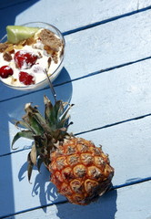 Pineapple and bowl of yogurt and fruit