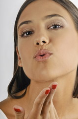 Female young adult blowing a kiss