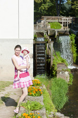 mother with her daughte at water mill in Ratiborice, Czech Repub