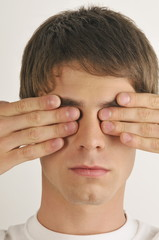 """""""Young male adult;hands covering eyes"""""""