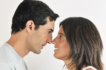 Young adult couple touching noses