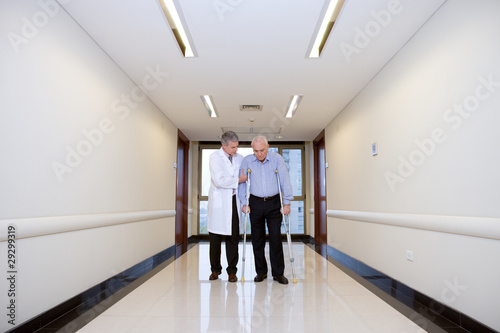Doctor helping a senior man