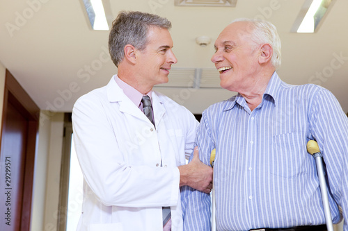 Doctor assisting a disabled senior
