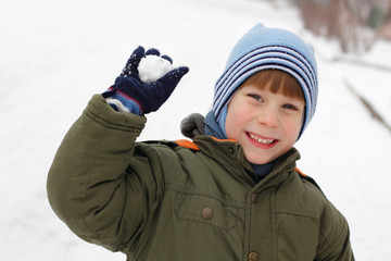 child have fun with snowball fight