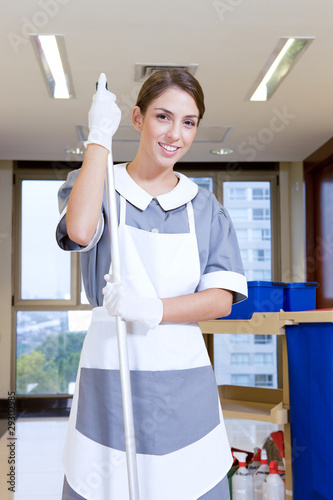 Attractive girl with a mop