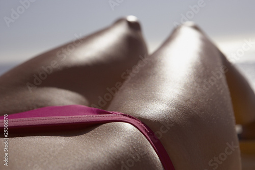 Closeup of woman in bikini waist down