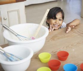 Girl baking cupcakes in kitchen