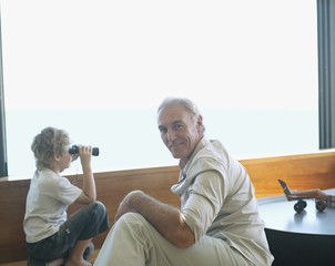 Grandfather and grandson with binoculars