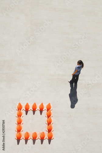 Woman outside box of traffic cones