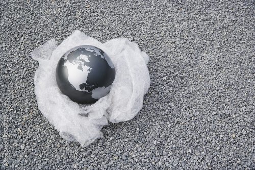 Globe on bubble wrap outdoors