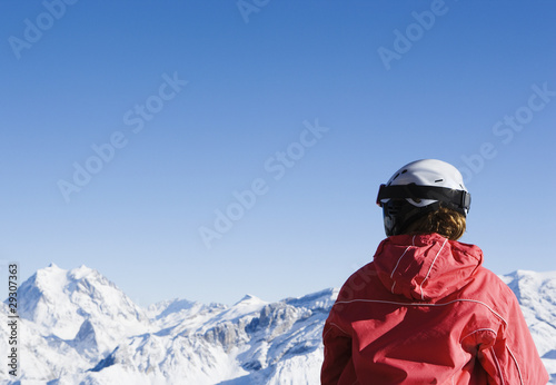 A girl looking out over snowy mountains
