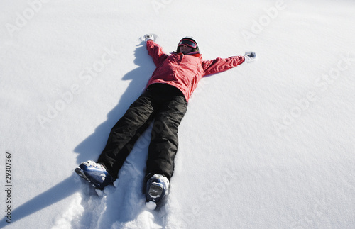 A girl making a snow angel