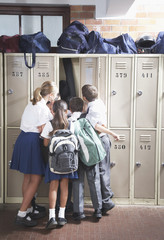 Students in the school hallway looking in a locker