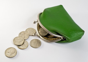 Coins spill out of the old purse