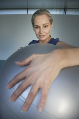 Woman holding a pilates ball in front of herself