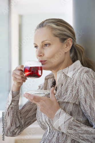 Woman relaxing outdoors sipping a cup of tea