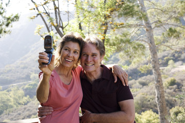 Couple taking picture of themselves with camera phone