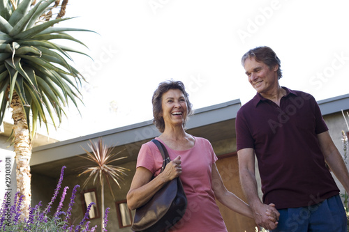 Couple holding hands leaving home