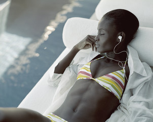 A woman relaxing and listening to music