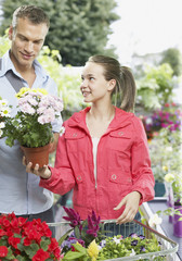 Man and girl shopping for flowers