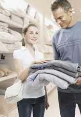 Man and girl looking at towels in a store