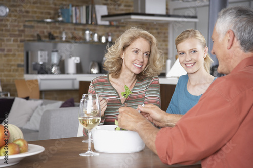 Couple eating salad with girl